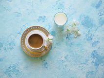 Black coffee and a glass of milk on a turquoise background. Ramadan food. Black coffee and a glass of milk on a turquoise background. Ramadan food royalty free stock photos