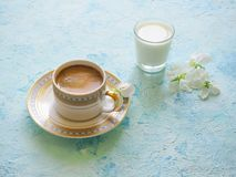 Black coffee and a glass of milk on a turquoise background. Ramadan food. Black coffee and a glass of milk on a turquoise background. Ramadan food royalty free stock photography