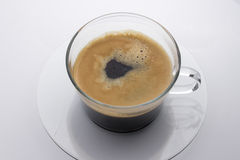 Black coffee in Glass with Saucer Royalty Free Stock Photo