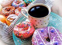 Black coffee and glazed doughnuts. A cup of black coffee and glazed doughnuts on plate royalty free stock photo