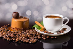 Black Coffee with Gourmet Chocolate Cake and Beans Stock Image