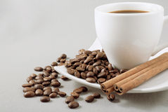 Black coffee, grains and cinnamon Royalty Free Stock Photo