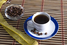 Black coffee and grains of coffee on a saucer Royalty Free Stock Photo