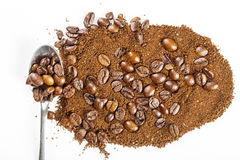 Black coffee grains and Grinded. Close-up aroma arabic coffee grains and Grinded Royalty Free Stock Photography