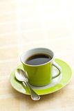Black coffee in green cup Stock Photography
