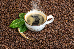 Black coffee green leaves caffee beans background Stock Photography