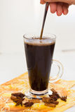 Black Coffee with hand. Black coffee with sugar, stirring spoon hand Stock Images