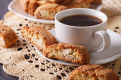 Black coffee and Italian cookies cantuccini macro. Horizontal Stock Photos