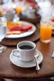 Black coffee, juice and fruits for breakfast at a Stock Image