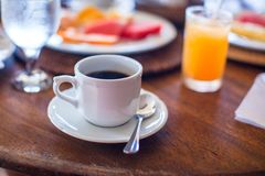 Black coffee, juice and fruits for breakfast at a Royalty Free Stock Photo