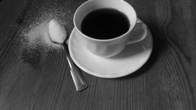 Black coffee. A little white cup of coffee Royalty Free Stock Image