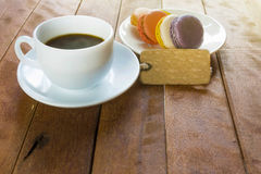 Black coffee with macaroons Royalty Free Stock Images