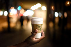 Black Coffee. Male Hand Holding Coffee Cup at Night Stock Photos