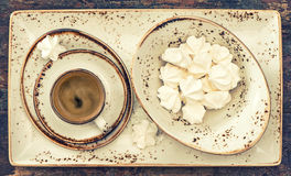 Black coffee with meringue cookies. Retro style picture Royalty Free Stock Photos
