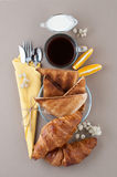 Black coffee, milk, croissants and toast close-up on a light bro Royalty Free Stock Photos