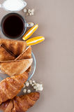 Black coffee, milk, fresh croissants and toasts on the side on a Royalty Free Stock Photography