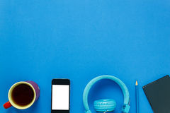 black coffee,mobile phone,pencil,note paper and headpho Stock Images