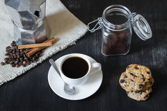 Black coffee with moka pot and cookies. Royalty Free Stock Photo