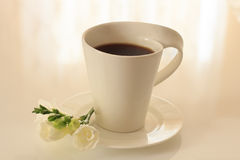 Black coffee in a mug on a saucer Royalty Free Stock Photos