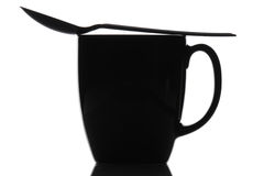 Black Coffee Mug and Spoon Stock Photo