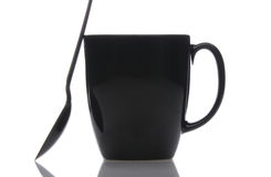 Black Coffee Mug and Spoon Stock Image