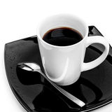 Black coffee mug with spoon on saucer Royalty Free Stock Photography