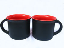 Black Coffee Mugs. Nice designer black-red colored porcelain coffee mugs stock image