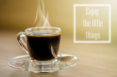 Black coffee and a note  Enjoy the little things. Black coffee and a note  Enjoy the little things reminding us to appreciate even the simple moments in life Royalty Free Stock Photography