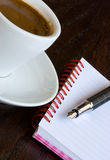 Black Coffee and notebook Stock Image