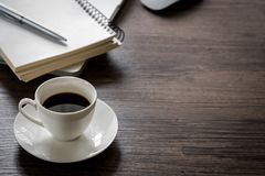 Black coffee on the office desk table with computer, silver pen. Business desk table top view with copy space concept Stock Images