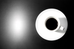 Black coffee with one light point Royalty Free Stock Image