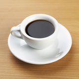 Black Coffee over the Table Royalty Free Stock Photo