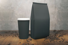Black coffee package and cup Stock Images
