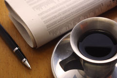 Black Coffee, Pen and Newspaper Royalty Free Stock Image