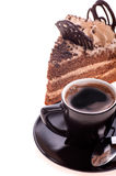 Black coffee and a piece of cake. On a white Stock Photography