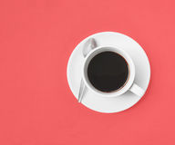 Black coffee on pink Stock Image