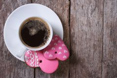 Black coffee and pink heart cookies on the table Stock Image