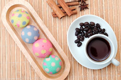 Black coffee and  polka dot muffin Stock Photos