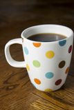 Black Coffee in a Polka Dot Mug Royalty Free Stock Photo