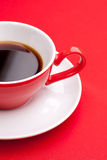 Black coffee in a porcelain dish. Of red Stock Photos