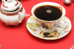 Black coffee on a red cloth royalty free stock photography
