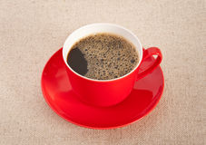 Black coffee in red cup with saucer Stock Photos