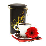 Black coffee and red flower. Cup, a red flower and a jar of coffee on a white background Royalty Free Stock Image