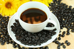 Black coffee with reflection. Aromatic black coffee in white cup. Fire reflection Stock Photo