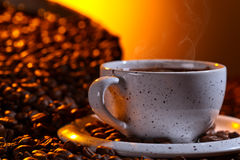 Black coffee and roasted beans Royalty Free Stock Images