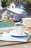 Drinking coffee at a Greek island Stock Images