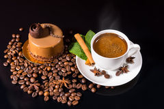 Black Coffee Served with Gourmet Chocolate Cake. High Angle Still Life View of Frothy Black Cup of Coffee Served with Cinnamon Stick, Fresh Mint and Star Anise Royalty Free Stock Photography