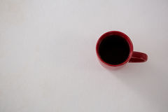 Black coffee served in red cup Royalty Free Stock Photo