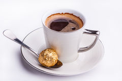 Black coffee served with sweet chocolate. Royalty Free Stock Photos