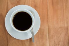 Black coffee served in white cup Royalty Free Stock Image